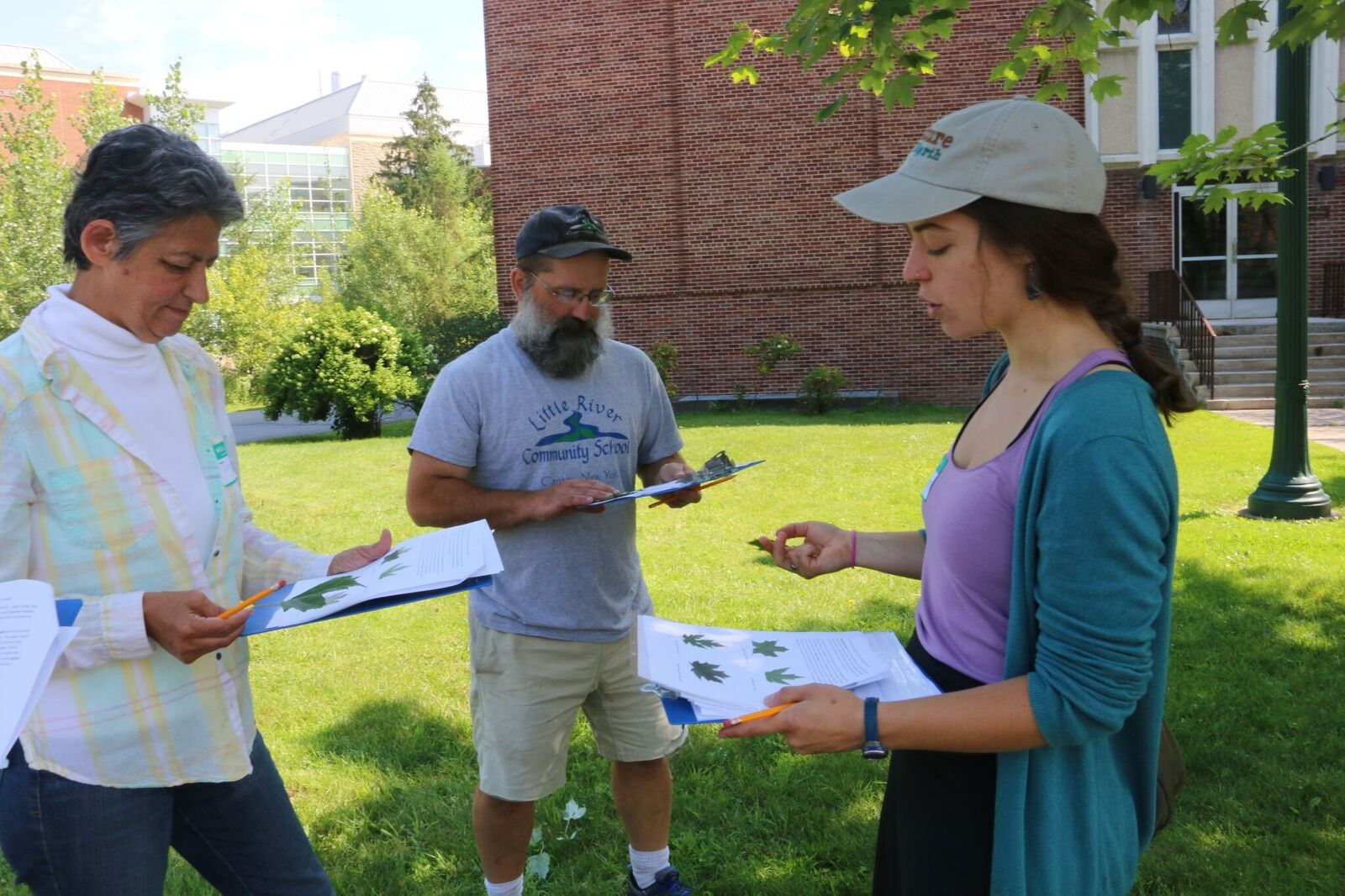 Emlyn Crocker from Nature Up North talks tree ID with local teachers outside on the SLU campus.