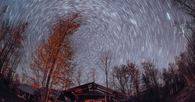 A long exposure shot of stars the movement of stars throughout the night sky.