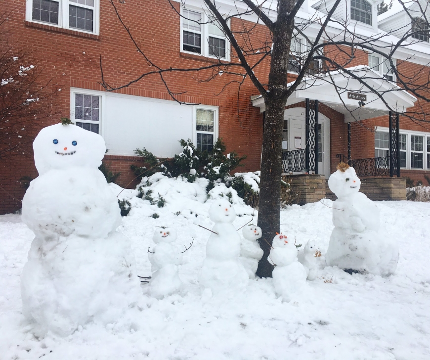 A snow family in front of the Arts Annex at St. Lawrence University