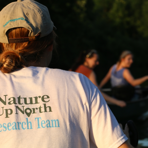 Nature Up North intern canoeing on the Grasse River